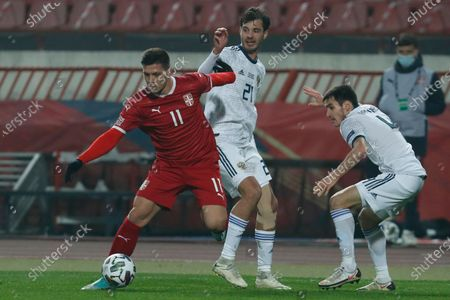 Serbia's Luka Jovic left, is challenged by Russia's Anton Miranchuk, centerr during the UEFA Nations League soccer match between Serbia and Russia at the Rajko Mitic Stadium, in Belgrade, Serbia