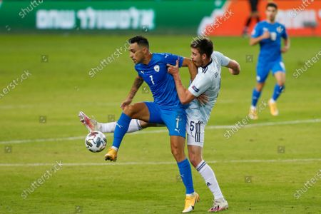 Eran Zahavi, left, and Scotland's Declan Gallagher fight for the ball during the UEFA Nations League soccer match between Israel and Scotland in Netanya, Israel