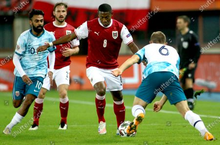 Norway's Ghayas Zahid, left, and Julian Ryerson, right, challenge for the ball with Austria's David Alaba, center, during a UEFA Nations League soccer match between Austria and Norway at the Ernst-Happel-Stadium in Vienna, Austria