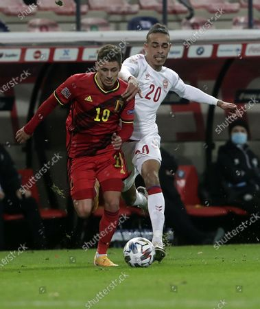 Thorgan Hazard (L) of Belgium in action against Yussuf Poulsen of Denmark during the UEFA Nations League match between Belgium and Denmark in Leuven, Belgium, 18 November 2020.