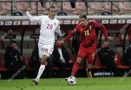 Thorgan Hazard (R) of Belgium in action against Yussuf Poulsen of Denmark during the UEFA Nations League match between Belgium and Denmark in Leuven, Belgium, 18 November 2020.