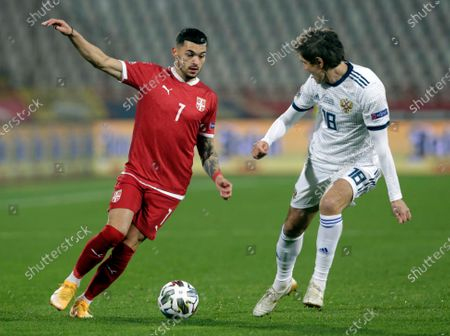 Serbia's Nemanja Radonjic (L) in action against Russia's Yuri Zhirkov (R) during  the UEFA Nations League, League B, group 3 match, between Serbia and Russia in Belgrade, Serbia, 18 November 2020.