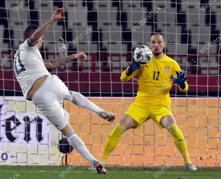 Russia's Anton Zabolotny (L) in action against Serbia goalkeeper Predrag Rajkovic (R) during the UEFA Nations League, League B, group 3 match, between Serbia and Russia in Belgrade, Serbia, 18 November 2020.