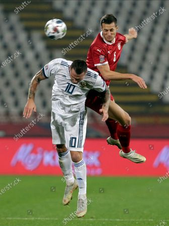 Russia's Anton Zabolotny (L) in action against Serbia's Uros Spajic (R) during the UEFA Nations League, League B, group 3 match, between Serbia and Russia in Belgrade, Serbia, 18 November 2020.