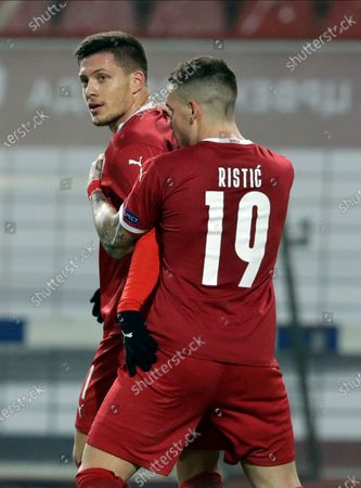 Serbia's Luka Jovic (L) celebrates with Mihailo Ristic (R) after scoring the 2-0 goal during the UEFA Nations League, League B, group 3 match, between Serbia and Russia in Belgrade, Serbia, 18 November 2020.