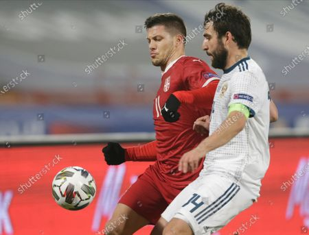 Serbia's Luka Jovic (L) in action against Russia's Georgi Dzhikiya (R) during the UEFA Nations League, League B, group 3 match, between Serbia and Russia in Belgrade, Serbia, 18 November 2020.