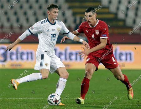 Russia's Anton Miranchuk (L) in action against Serbia's Nikola Milenkovic (R) during the UEFA Nations League, League B, group 3 match, between Serbia and Russia in Belgrade, Serbia, 18 November 2020.