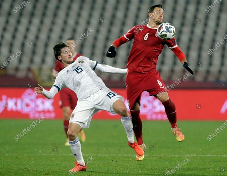 Serbia's Nemanja Maksimovic (R) in action against Russia's Aleksei Miranchuk (L) during the UEFA Nations League, League B, group 3 match, between Serbia and Russia in Belgrade, Serbia, 18 November 2020.