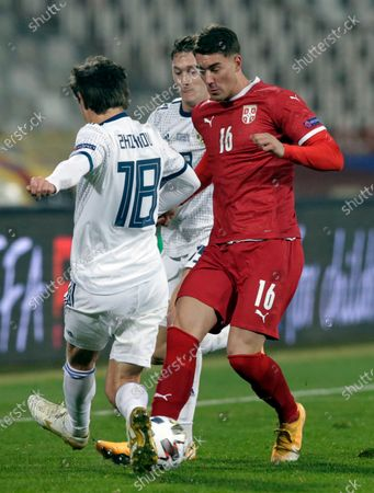 Serbia's Dusan Vlahovic (R) in action against Russia's Yuri Zhirkov (L) during the UEFA Nations League, League B, group 3 match, between Serbia and Russia in Belgrade, Serbia, 18 November 2020.