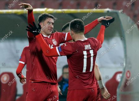 Serbia's Dusan Vlahovic (L) celebrates with Luka Jovic after scoring the 3-0 goal during the UEFA Nations League, League B, group 3 match, between Serbia and Russia in Belgrade, Serbia, 18 November 2020.