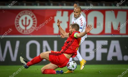 Belgium's Jan Vertonghen and Danish Martin Braithwaite fight for the ball during a soccer game between the Belgian national team Red Devils and Denmark, Wednesday 18 November 2020 in Leuven, on the sixth and last day of the group stage (group A2) of the Nations League.