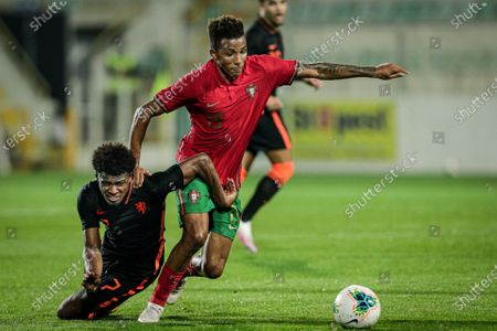 Portugal national soccer team player, Gelson Fernandes (R), in action against Netherlands national soccer player Javairo Dilrosun during their qualifying Under-21 2021 European Championship (Euro-2021) soccer match held at Portimao Stadium, Portimao, Portugal, 18th November 2020.