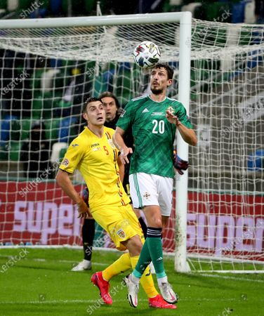 Northern Ireland's Craig Cathcart with Romania's Alin Tosca