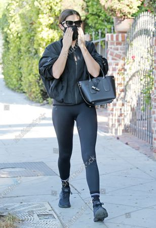 Sara Sampaio adjusts her mask as she heads into the gym in West Hollywood