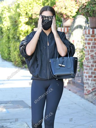 Sara Sampaio adjusts her sunglasses as she heads into the gym in West Hollywood