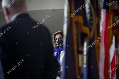 Stock Image of Speaker of the United States House of Representatives Nancy Pelosi (Democrat of California) listens as United States House Assistant Democratic Leader James Clyburn (Democrat of South Carolina) offers remarks as they are joined by other members of the House Democratic leadership, to offer remarks and field questions from reporters during a press conference at the US Capitol in Washington, DC,.