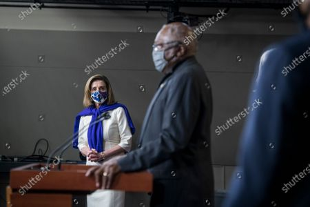 Speaker of the United States House of Representatives Nancy Pelosi (Democrat of California), left, listens as United States House Assistant Democratic Leader James Clyburn (Democrat of South Carolina) offers remarks as they are joined by other members of the House Democratic leadership, to offer remarks and field questions from reporters during a press conference at the US Capitol in Washington, DC,.