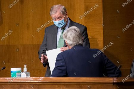 United States Senator Lindsey Graham (Republican of South Carolina), Chairman, US Senate Judiciary Committee, left, chats with US Senator Sheldon Whitehouse (Democrat of Rhode Island) prior to a Senate Committee on the Judiciary nominations hearing in the Dirksen Senate Office Building in Washington, DC,.