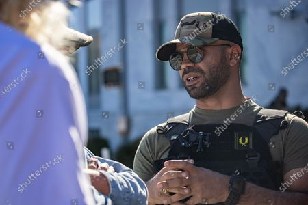 Enrique Tarrio, leader of the proud boys, is seen at a 'Stop the Steal' protest outside of the Georgia state capitol