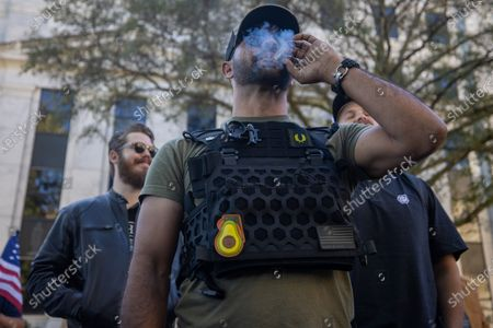 Stock Image of Enrique Tarrio, leader of the proud boys, is seen at a 'Stop the Steal' protest outside of the Georgia state capitol