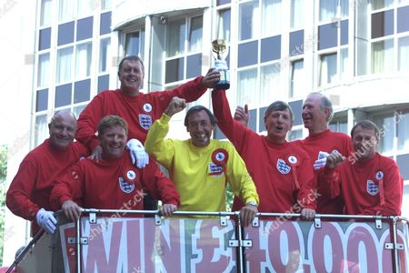 35 Years On From The 1966 Football World Cup Win Seven Of The Team Promote National Lottery Instants Draw With Newly Found Replica Of The Jules Rimet Trophy. (l-r) George Cohen Alan Ball Geoff Hurst Gordon Banks Jack Charlton Martin Peters Roger Hunt.