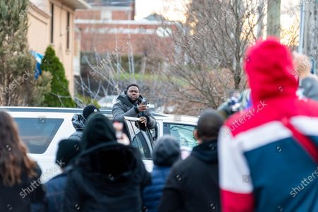 Kevin Hart pauses while leaving the set to thank fans waiting nearby for their support