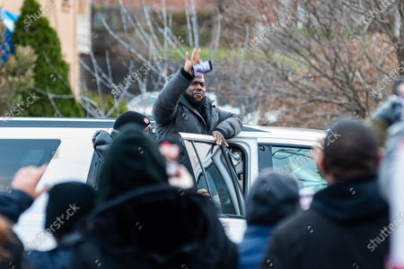 Stock Image of Comedian and actor Kevin Hart pauses while leaving the set to thank fans waiting near by for their support