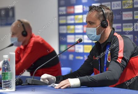 Stock Image of Head coach Vitor Perreira (R) and player Aaron Mooy of Shanghai SIPG attend a press conference ahead of the group H match of AFC Champions League between Shanghai SIPG of China and Sydney FC of Australia in Doha, capital of Qatar Nov. 18, 2020.