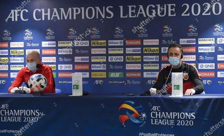 Head coach Vitor Perreira (R) and player Aaron Mooy of Shanghai SIPG attend a press conference ahead of the group H match of AFC Champions League between Shanghai SIPG of China and Sydney FC of Australia in Doha, capital of Qatar Nov. 18, 2020.