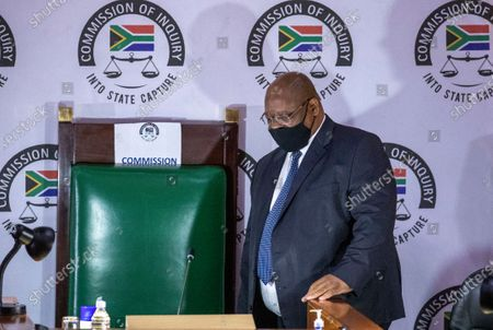 Judge Raymond Zondo, chairman of the Zondo Commission of Inquiry into State Capture, arrives in court, in Johannesburg, South Africa, . Former President Jacob Zuma is appearing before a state commission investigating serious allegations of corruption during his tenure as head of state between 2009 and 2018