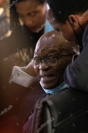 Former South African President Jacob Zuma, left, talks with his lawyer Muzi Sikhakhane, as he waits for the state capture hearings to get underway, in Johannesburg, South Africa, . Former President Jacob Zuma is appearing before a state commission investigating serious allegations of corruption during his tenure as head of state between 2009 and 2018