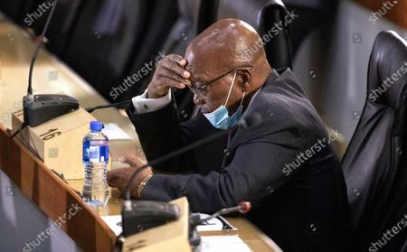 Former South African President Jacob Zuma, appears at the hearing for his application for Deputy Chief Justice Raymond Zondo, to recuse himself from the state capture commission inquiry, in Johannesburg, South Africa, . Former President Jacob Zuma is appearing before a state commission investigating serious allegations of corruption during his tenure as head of state between 2009 and 2018