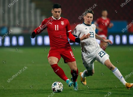 Serbia's Luka Jovic, left, duels for the ball with Russia's Daler Kuzyaev during the UEFA Nations League soccer match between Serbia and Russia at the Rajko Mitic Stadium, in Belgrade, Serbia