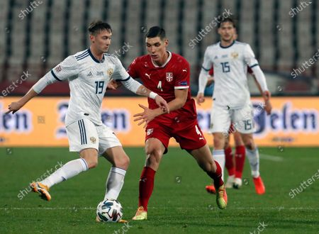 Russia's Anton Miranchuk, left, duels for the ball with Serbia's Nikola Milenkovic during the UEFA Nations League soccer match between Serbia and Russia at the Rajko Mitic Stadium, in Belgrade, Serbia
