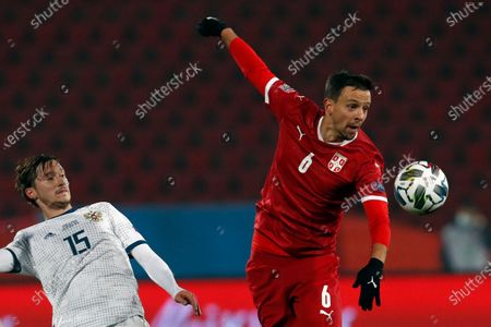 Serbia's Nemanja Maksimovic, right, duels for the ball with Russia's Aleksei Miranchuk during the UEFA Nations League soccer match between Serbia and Russia at the Rajko Mitic Stadium, in Belgrade, Serbia