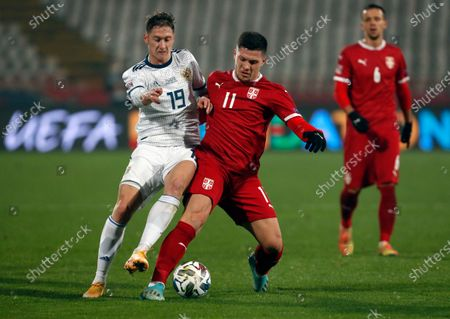 Russia's Anton Miranchuk, left, duels for the ball with Serbia's Luka Jovic during the UEFA Nations League soccer match between Serbia and Russia at the Rajko Mitic Stadium, in Belgrade, Serbia