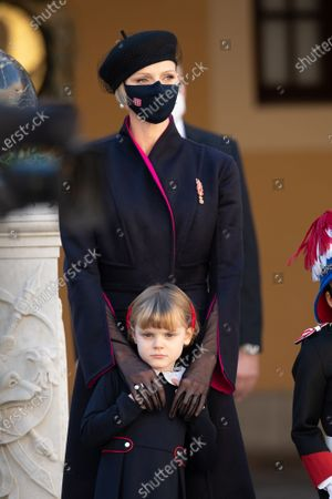Princess Charlene of Monaco and Princess Gabriella of Monaco attend a medal ceremony at the Monaco Palace