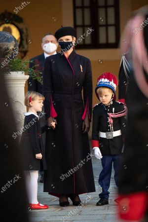 Princess Charlene of Monaco, Crown Prince Jacques of Monaco and Princess Gabriella of Monaco attend a medal ceremony at the Monaco Palace