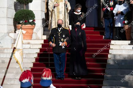 Prince Albert II of Monaco, Princess Charlene of Monaco and Princess Caroline of Hanover leaving the cathedral of Monaco