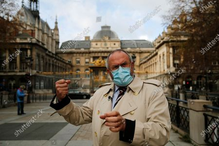 British Chris Norman gestures during an interview with the Associated Press, in front of the Paris courthouse, during the Thalys attack trial, . The lawyer for an American who was scheduled to testify about his role in the dramatic capture of an Islamic State operative aboard a high-speed train says his witness has been hospitalized after he flew in to Paris
