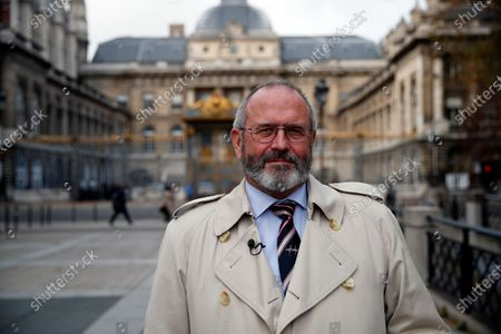 British Chris Norman poses after an interview with the Associated Press, in front of the Paris courthouse, during the Thalys attack trial, . The lawyer for an American who was scheduled to testify about his role in the dramatic capture of an Islamic State operative aboard a high-speed train says his witness has been hospitalized after he flew in to Paris