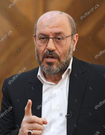 """Gen. Hossein Dehghan, a military advisor to Iran's Supreme Leader Ayatollah Ali Khamenei, speaks during an interview with The Associated Press in Tehran, Iran, . Dehghan, who is a possible 2021 presidential candidate, warned that any American attack on the Islamic Republic could set off a """"full-fledged war"""" in the Mideast in the waning days of the Trump administration"""