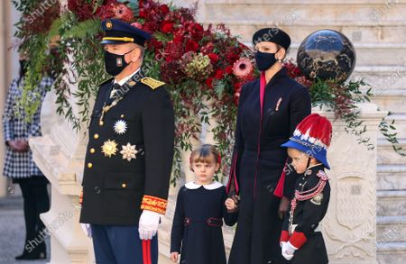 Prince Albert II of Monaco (L), Princess Charlene of Monaco (2-R), Princess Gabriella of Monaco (2-L) and Prince Jacques of Monaco attend the celebrations marking Monaco's National Day at the Palace, in Monaco, 19 November 2020. The National Day of Monaco is also known as The Sovereign Prince's Day.