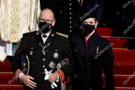 Prince Albert of Monaco (L) and his wife Princess Charlene of Monaco (R) leave the Cathedral of Monaco after attending the celebrations marking National Day at the Monaco Palace, in Monaco, 19 November 2020. The National Day of Monaco is also known as The Sovereign Prince's Day.