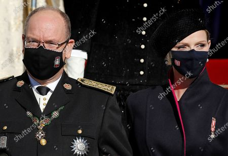 Stock Photo of Prince Albert of Monaco (L) and his wife Princess Charlene of Monaco (R) leave the Cathedral of Monaco after attending the celebrations marking National Day at the Monaco Palace, in Monaco, 19 November 2020. The National Day of Monaco is also known as The Sovereign Prince's Day.  *** Local Caption *** 55643684