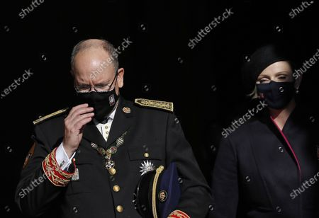 Stock Picture of Prince Albert of Monaco (L) and his wife Princess Charlene of Monaco (R) leave the Cathedral of Monaco after attending the celebrations marking National Day at the Monaco Palace, in Monaco, 19 November 2020. The National Day of Monaco is also known as The Sovereign Prince's Day.  *** Local Caption *** 55643684