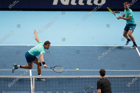 Kevin Krawietz of Germany and Andreas Mies of Germany return to Rajeev Ram of the United States and Joe Salisbury of Britain during their doubles tennis match at the ATP World Finals tennis tournament at the O2 arena in London