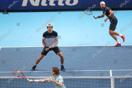Lukasz Kubot of Poland and Marcelo Melo of Brazil wait for the shot by Wesley Koolhof of the Netherlands and Nikola Mektic of Croatia during their doubles tennis match at the ATP World Finals tennis tournament at the O2 arena in London