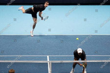 Rajeev Ram of the United States and Joe Salisbury of Britain serve to Kevin Krawietz of Germany and Andreas Mies of Germany during their doubles tennis match at the ATP World Finals tennis tournament at the O2 arena in London