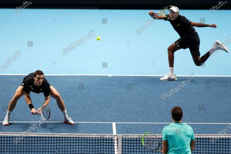Rajeev Ram of the United States and Joe Salisbury of Britain return to Kevin Krawietz of Germany and Andreas Mies of Germany during their doubles tennis match at the ATP World Finals tennis tournament at the O2 arena in London